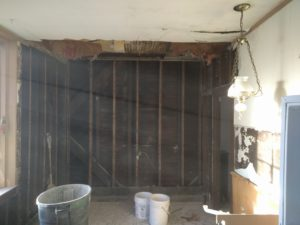 Cabinets and horse hair plaster removed.