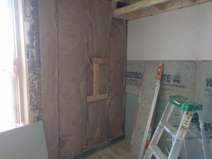 Insulated and wall board going up.